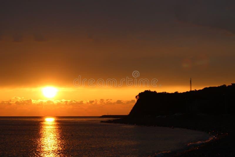 Заход солнца одно из самых завораживающих явлений природы стоковые изображения