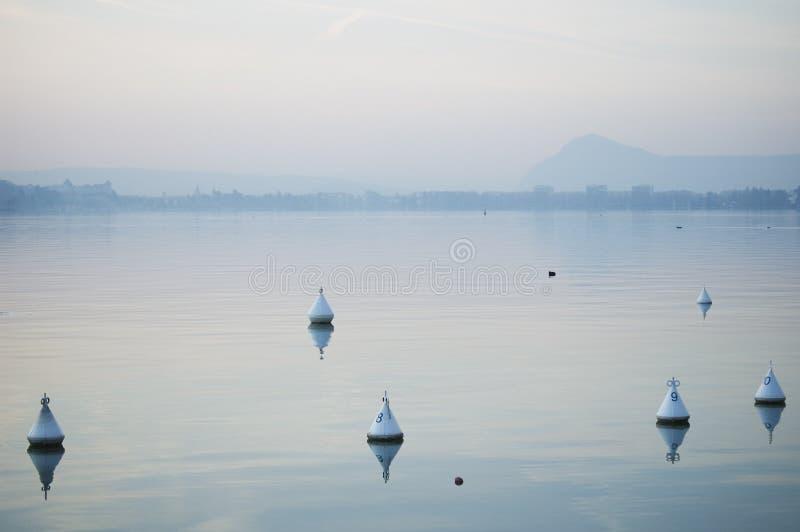 заход солнца озера annecy мирный стоковая фотография rf
