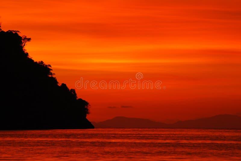 заход солнца острова последний стоковое изображение rf