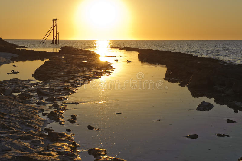 заход солнца острова стоковое изображение