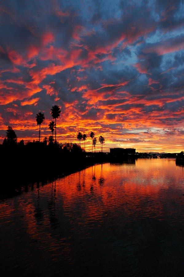 заход солнца отражения california стоковые изображения rf