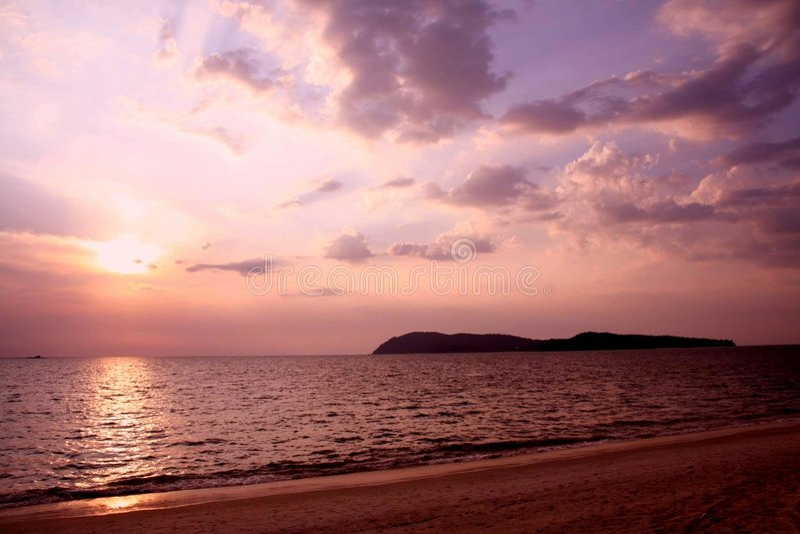 заход солнца пляжа стоковое изображение