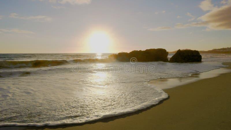Заход солнца пляжа Albufeira стоковая фотография rf