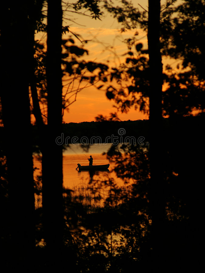 заход солнца рыболова стоковая фотография