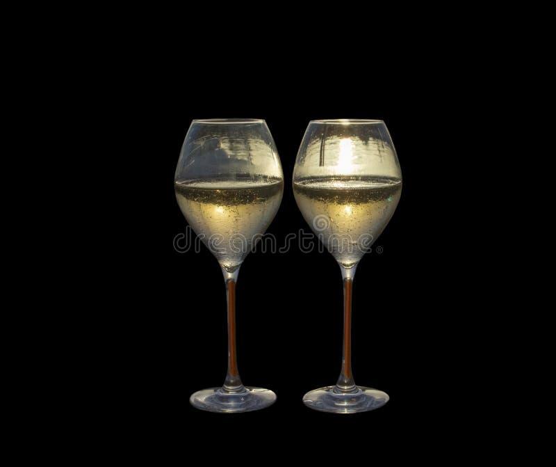 Заход солнца 2 стекел каннелюры шампанского стоковое изображение