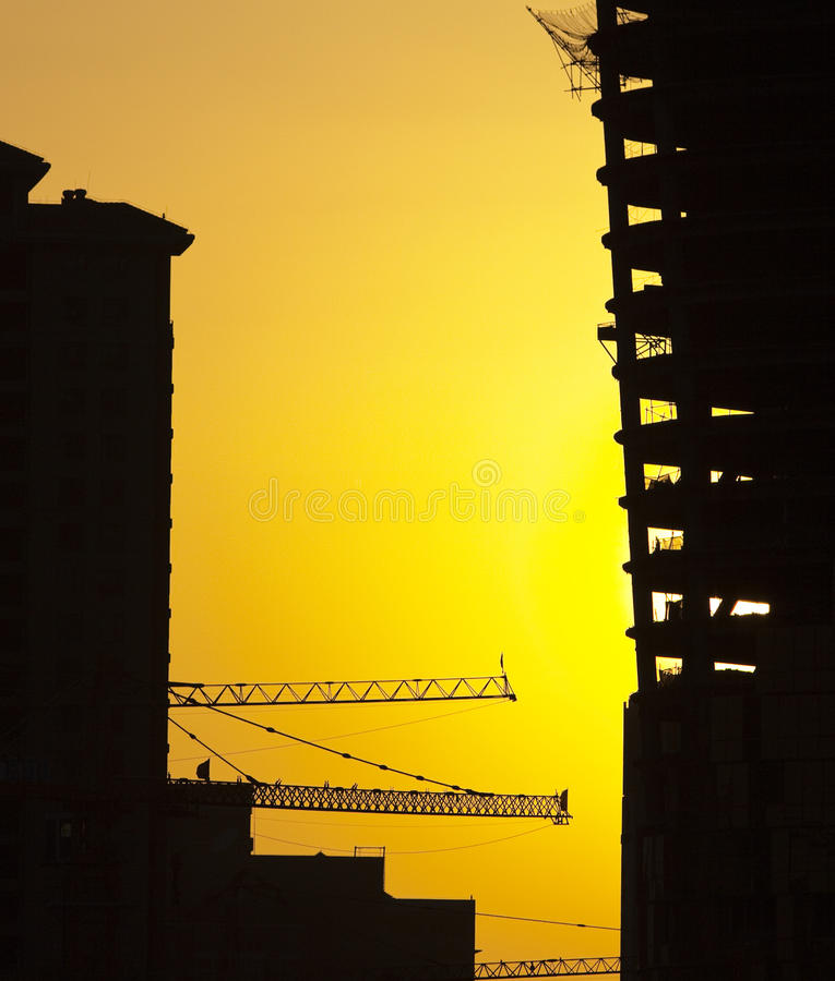 заход солнца строительной площадки стоковое фото