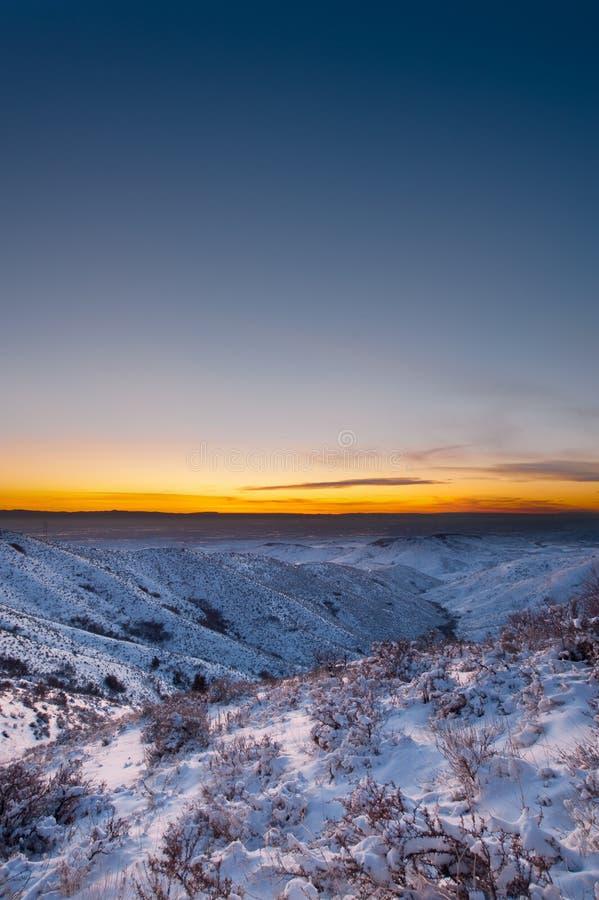 заход солнца удостоверения личности boise снежный стоковое изображение rf