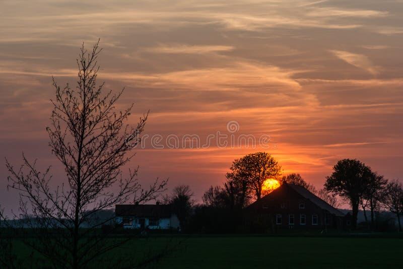 Заход солнца фермеров стоковая фотография rf