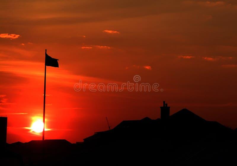 заход солнца флага стоковая фотография