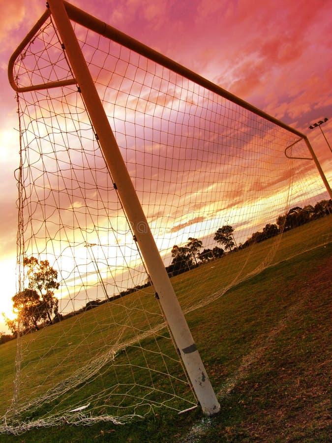 заход солнца футбола ii стоковая фотография rf