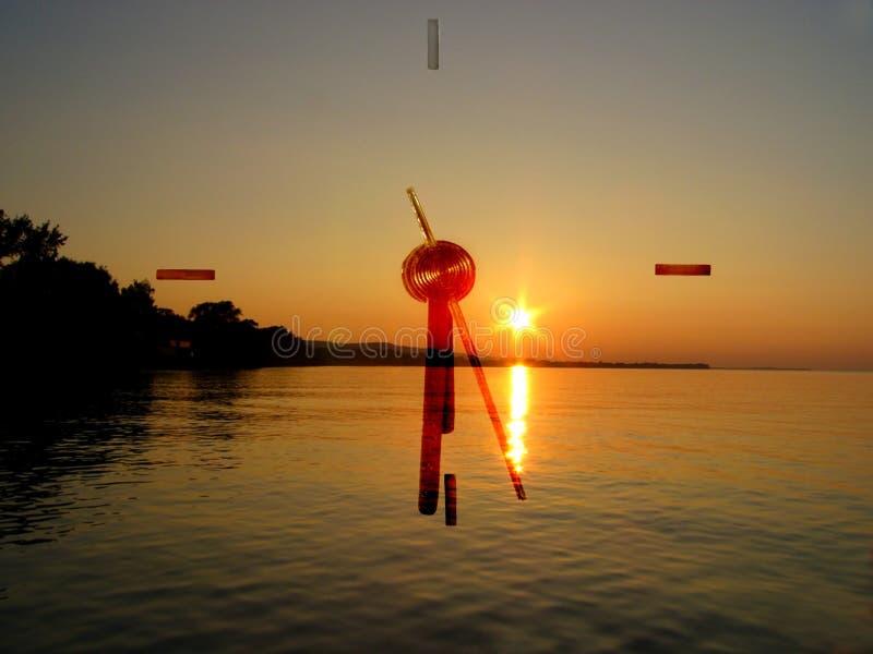 заход солнца часов стоковые фото