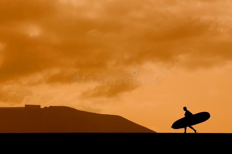 заход солнца longboarder стоковые фотографии rf
