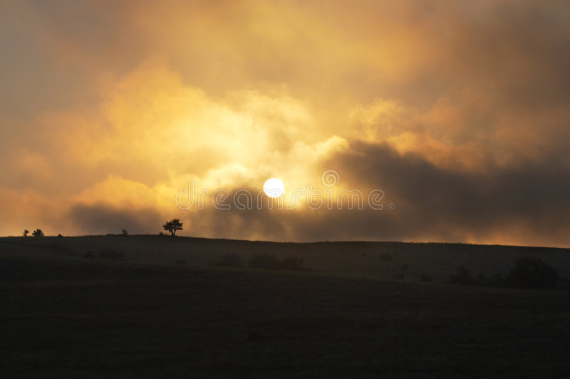 заход солнца overcast стоковые изображения