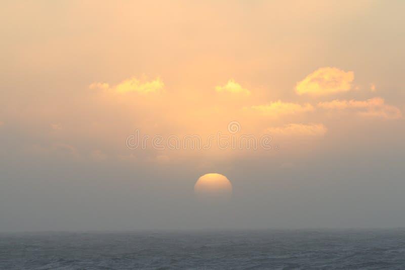 заход солнца pacific океана стоковое изображение