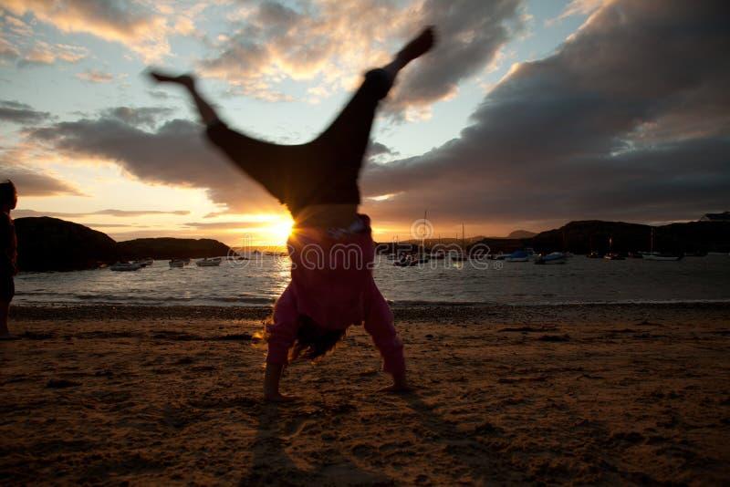 заход солнца porth diana стоковое фото rf