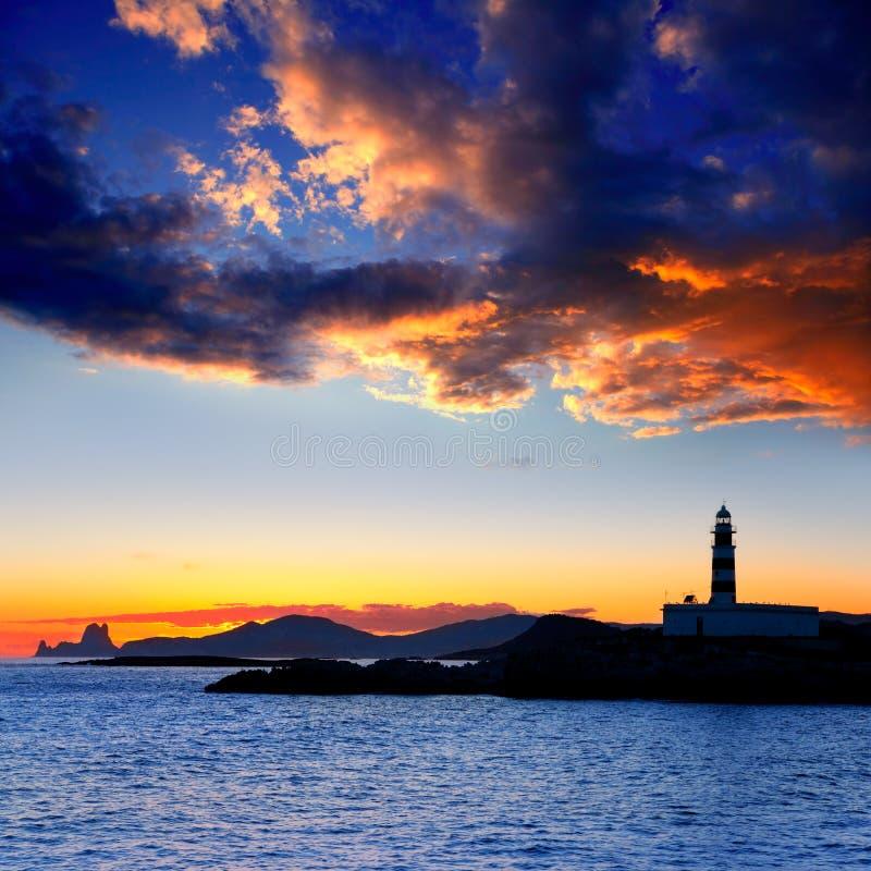 заход солнца vedra маяка острова ibiza freus es стоковое изображение rf