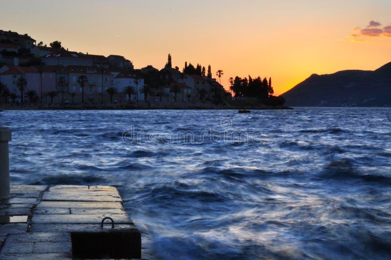 Заход солнца бурного моря стоковые изображения