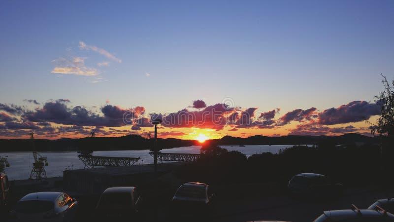 Заход солнца в гавани стоковые изображения