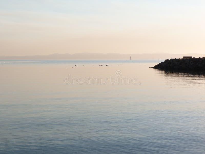 Заход солнца в заливе стоковые фотографии rf