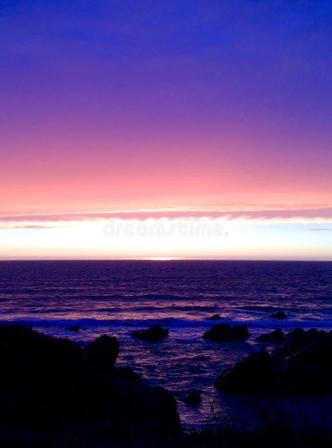 Заход солнца в дожде стоковая фотография rf