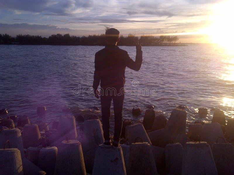 Заход солнца в пляже стоковое изображение rf