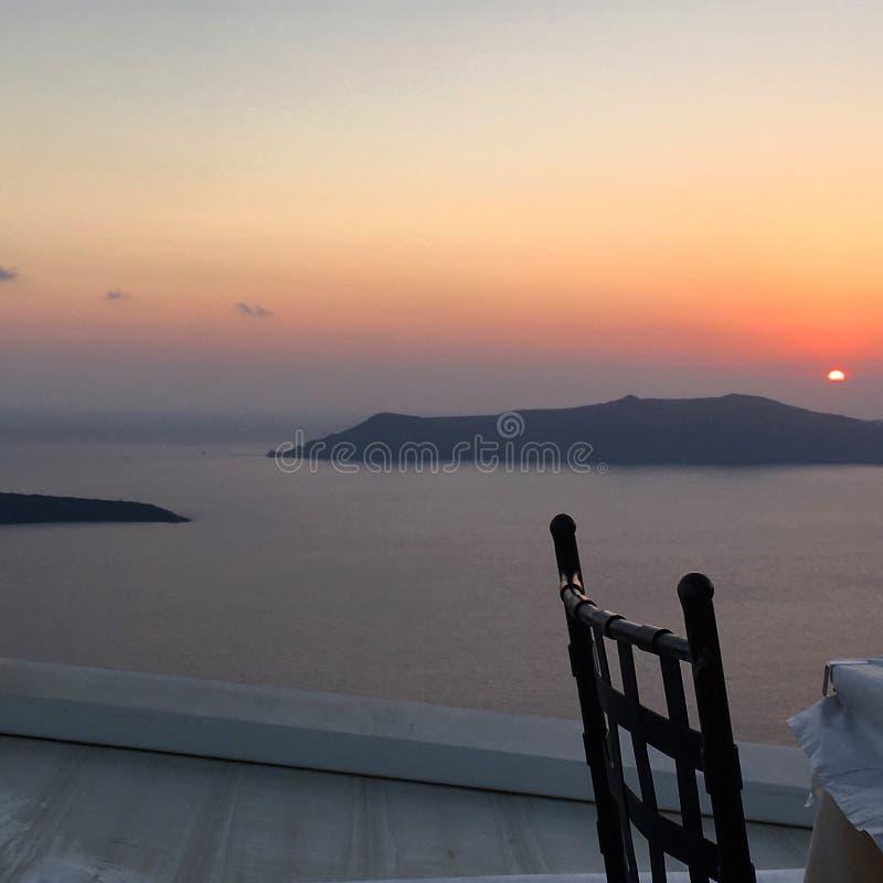 Заход солнца в santorini стоковое фото rf