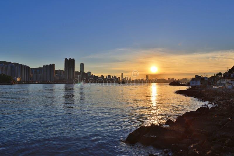 Заход солнца Гонконга, залив и маяк воды Yue Mun леев схвата Yau стоковое фото rf