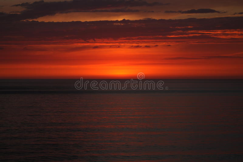 Заход солнца западного побережья стоковое фото