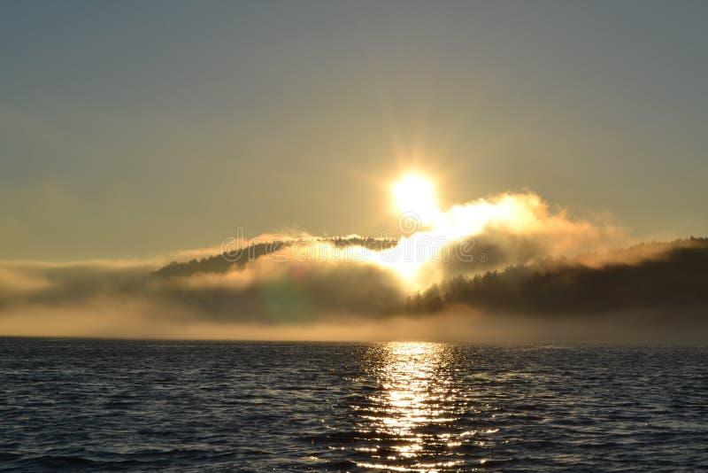 заход солнца звука puget стоковое фото
