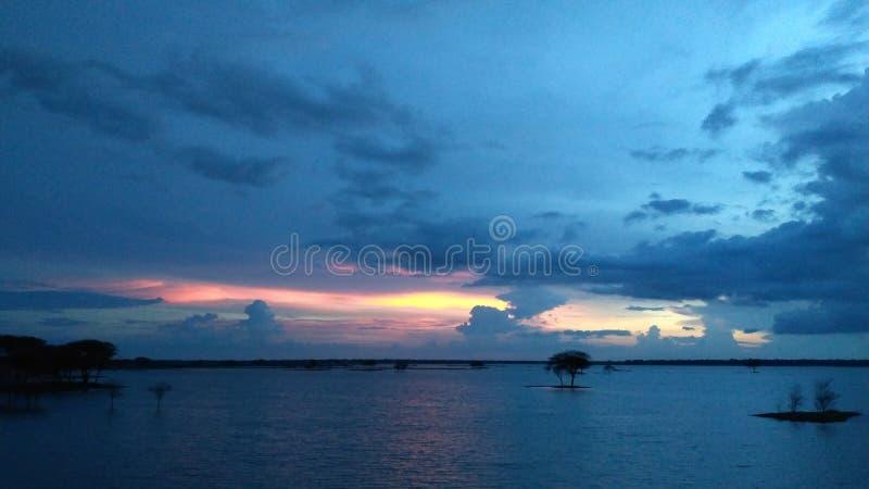 Заход солнца и облака стоковое фото rf