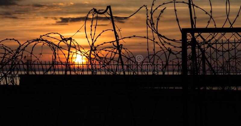 Заход солнца над военной базой стоковые фотографии rf