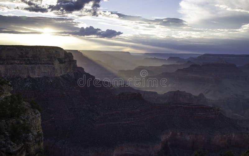 Заход солнца над грандиозным каньоном стоковая фотография rf