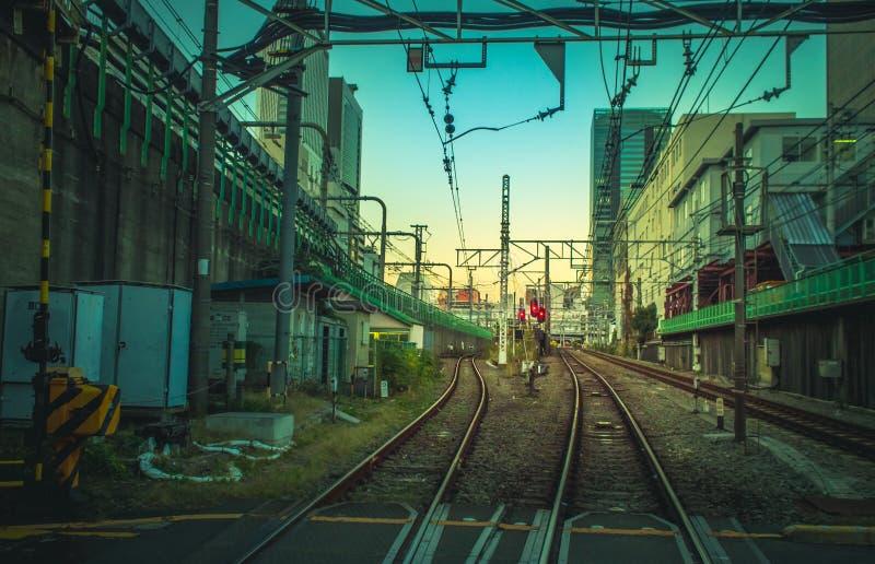 Заход солнца над железной дорогой стоковые фотографии rf