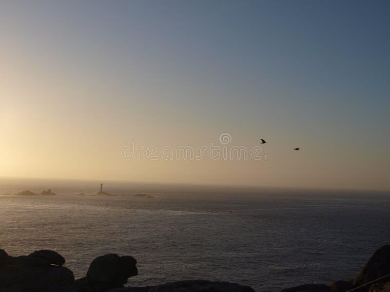 Заход солнца на конце земель в Корнуолле стоковое изображение