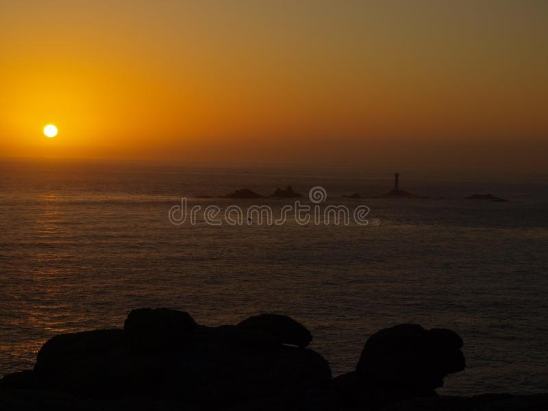 Заход солнца на конце земель в Корнуолле стоковые фотографии rf