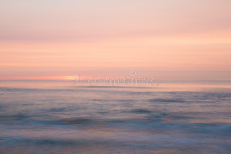 Заход солнца над морем стоковое фото