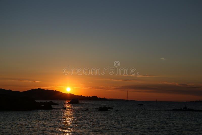 Заход солнца на море стоковое фото rf