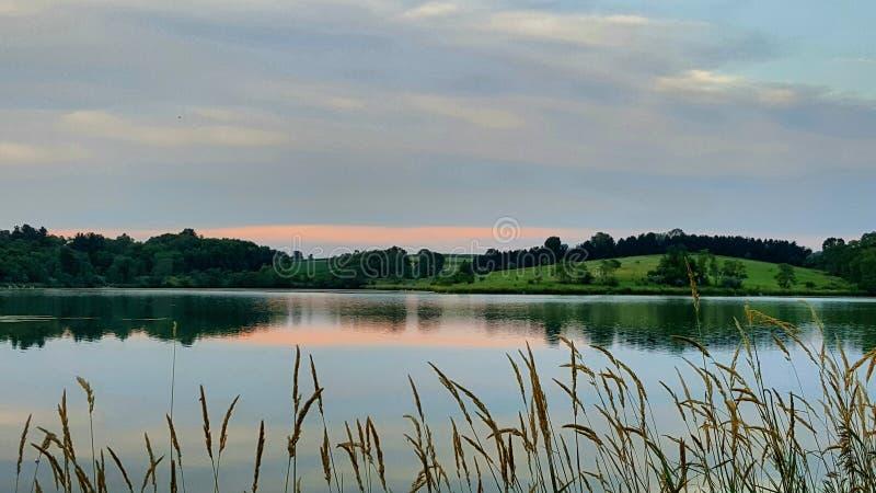 Заход солнца на озере стоковые изображения rf