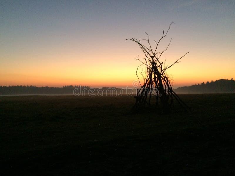 Заход солнца на открытой местности в стоковая фотография