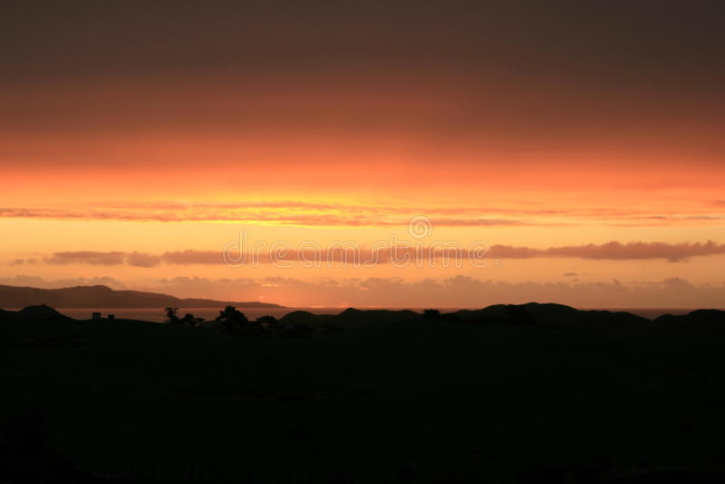 Заход солнца над пляжем 90mile стоковое фото