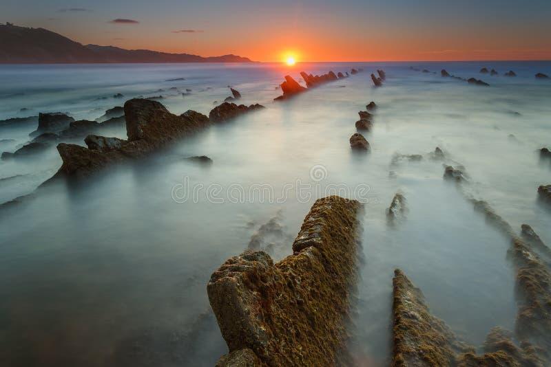 Заход солнца на пляже Sakoneta стоковые изображения