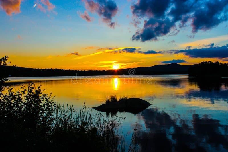 Заход солнца на шведском озере стоковое фото rf