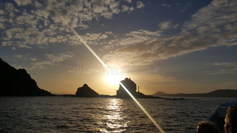Заход солнца на шлюпке стоковые фотографии rf