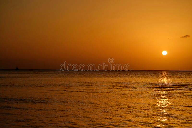 Заход солнца острова Доминики стоковое фото rf