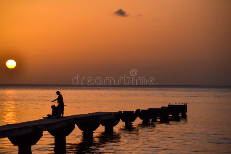 Заход солнца острова Доминики стоковое изображение