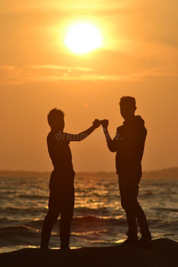 Заход солнца принадлежит мы стоковые фото