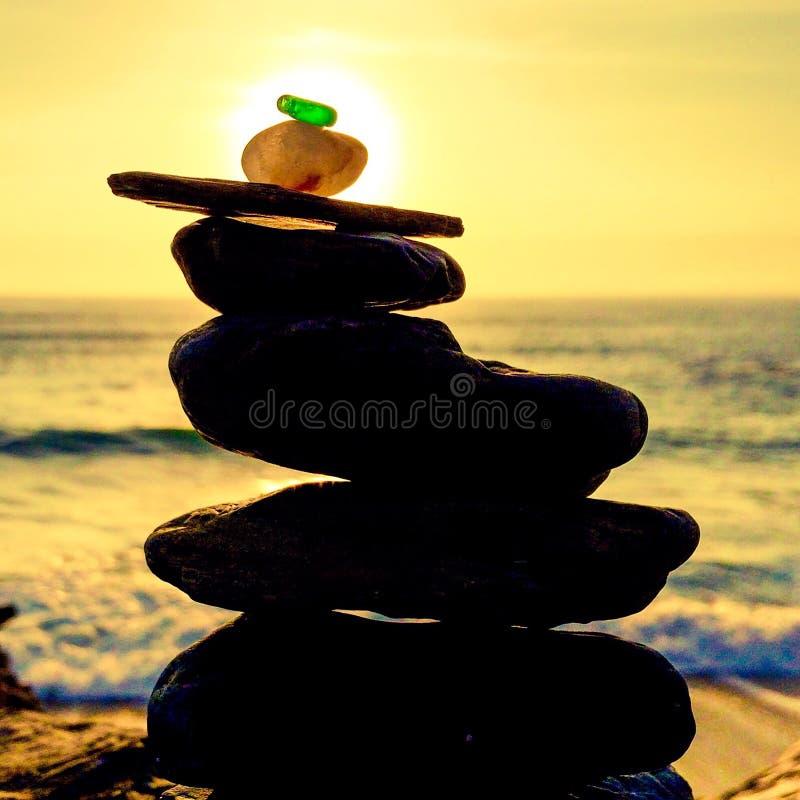 Заход солнца скульптуры моря стеклянный стоковая фотография