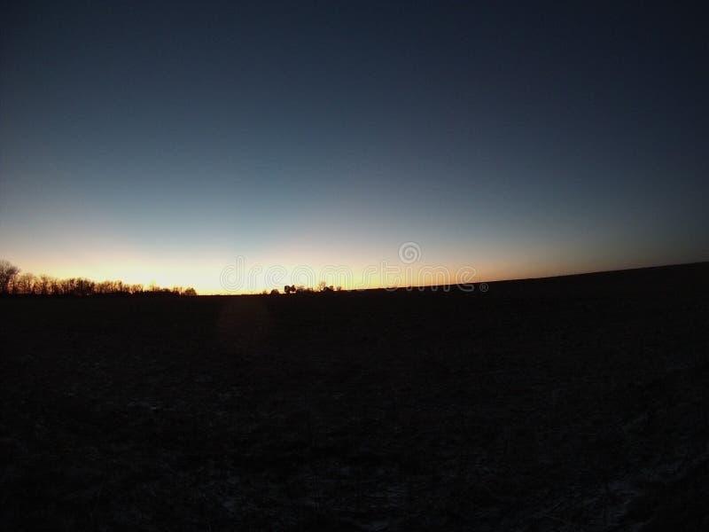 Заход солнца с ясным небом стоковое фото