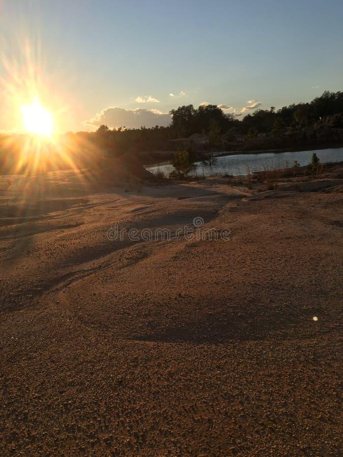 Заход солнца ям глины стоковая фотография