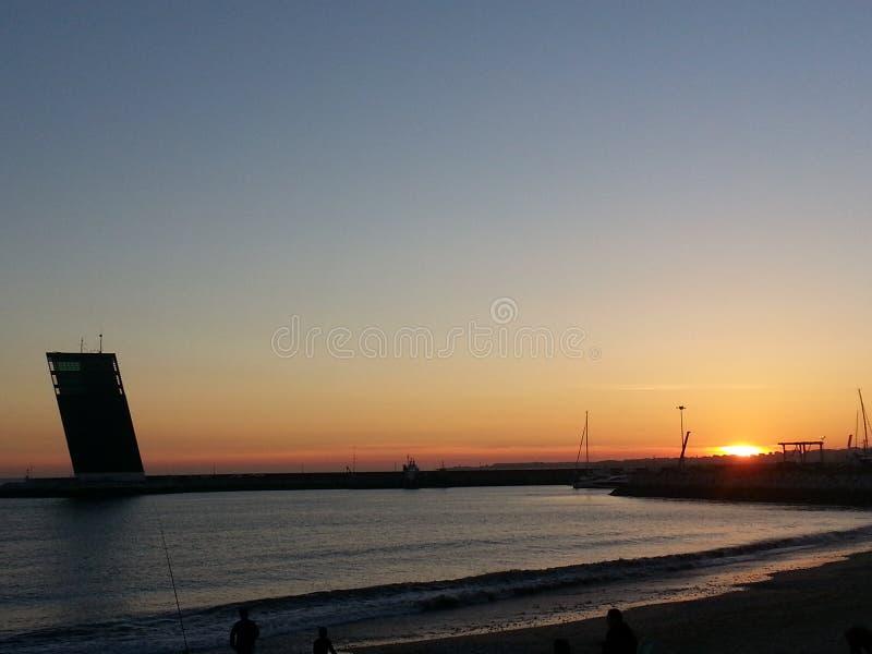 Заход солнца Algés стоковые фото